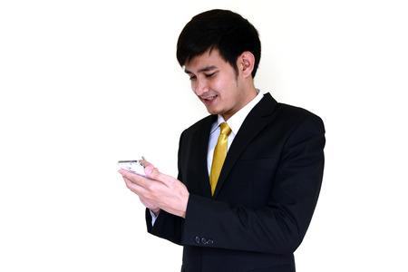 handsom: Asia hombre de negocios handsom utilizando tel�fono m�vil inteligente. Foto de archivo