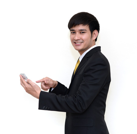 handsom: Asian handsom businessman using a smartphone and looking at camera isolated on a white background. Stock Photo