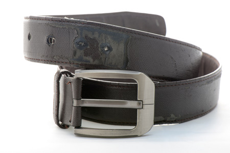 Brown leather men belt on white background. photo