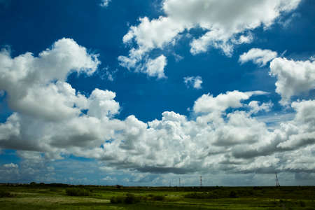 Dramatic Cloudscape in the blue sky. Multiple layers Clouds from far composed of dark and white Clouds. Standard-Bild