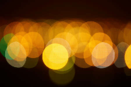 Night bokeh light, blur background of cityscape, blue color toned, abstract.