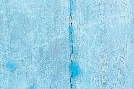 Blue Weathered and painted wooden texture background.