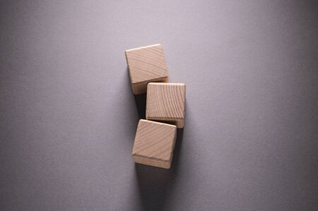 Wooden Geometric Shapes Cube on a paper background , This can use for past your words Stock Photo