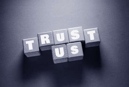 Trust Word Written on Wooden Cubes