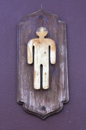 old toilet sign on cement wall photo