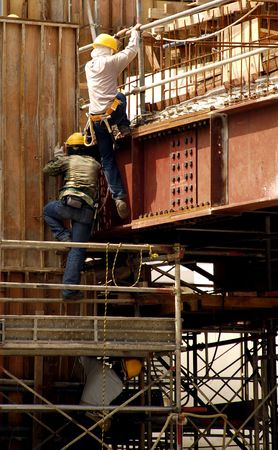 blue collar: Construction workers at work in the site