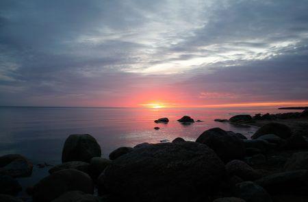 Sea sunset on baltic sea photo