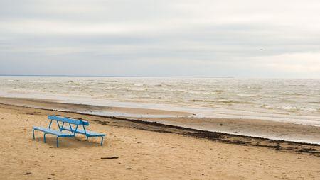 Blue bench on beach