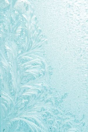 Ice pattern on window blue colour photo