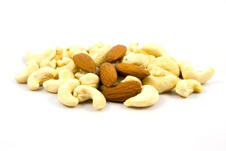 Cashew nuts and almonds isolated on white background photo