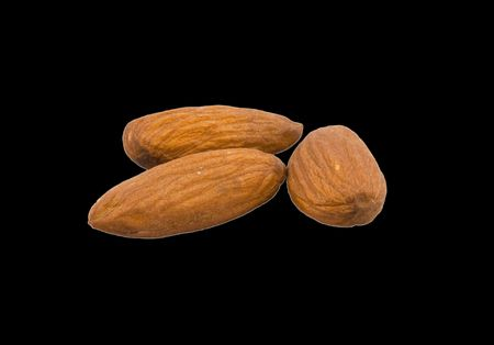 Group of almonds isolated on black