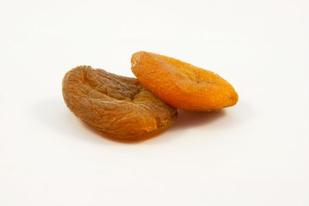 Group of dried Apricots natural isolated on white photo