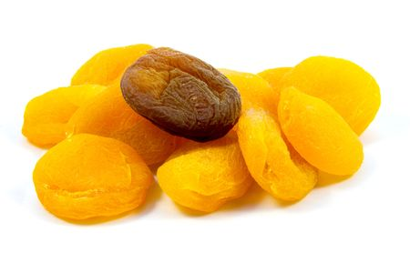 dried natural and sulfured apricots isolated on white background photo