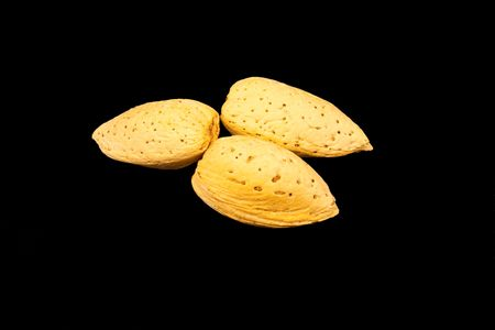 Almonds in shell isolated on black
