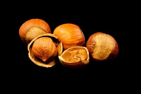 Hazelnuts on black background
