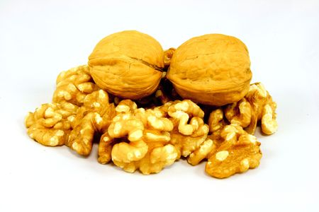 Walnuts in shell and kernels isolated on white photo
