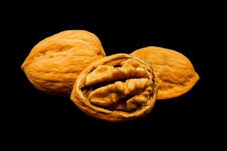 Walnuts in shell isolated on black
