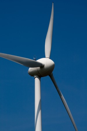 Stark White Electrical Power Generating Wind Turbines Stock Photo