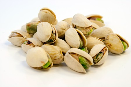 Salted pistachios isolated on white background  Stock Photo