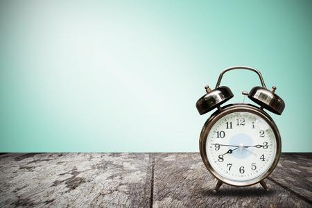 ten empty: Retro alarm clock on table front mint green background Stock Photo