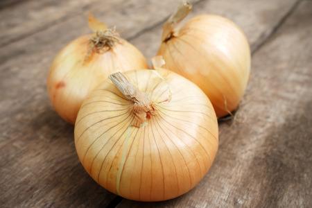 orange peel: Onion on wood