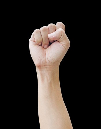 Male clenched fist, isolated on a black background