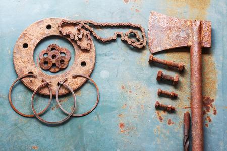 battleship: Old rusty tools on old steel background. vintage photo