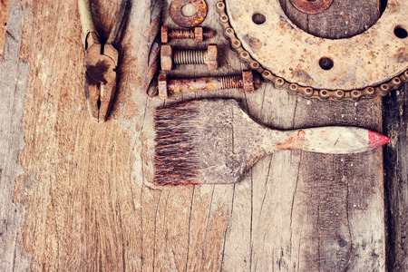 rusty nail: Old rusty tools on old wood background. vintage photo Stock Photo
