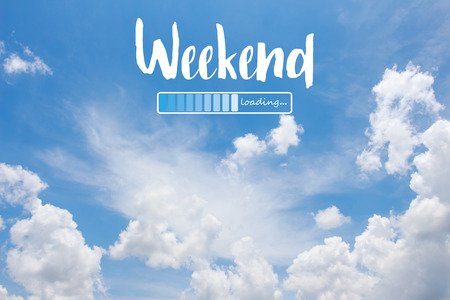 Weekend loading word on blue sky background Фото со стока - 104622815