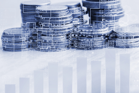 Stack of coins with growing graph for business finance concept