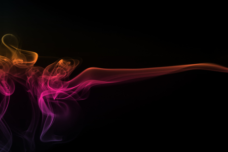 Abstract colorful smoke pattern on black background Stock Photo