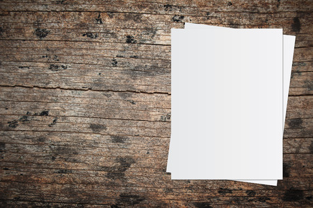 White paper and space for text on old wooden background Stockfoto
