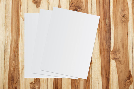 White template paper on wooden background