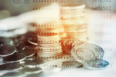Double exposure of stack of coins and bank account for finance concept Imagens