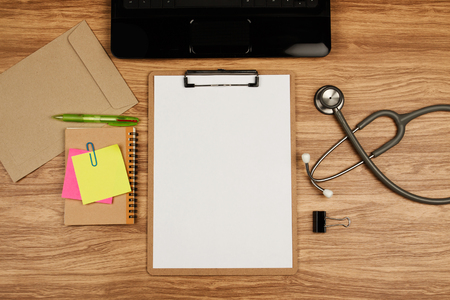 Clipboard with office supplies and stethoscope on wooden table, top view