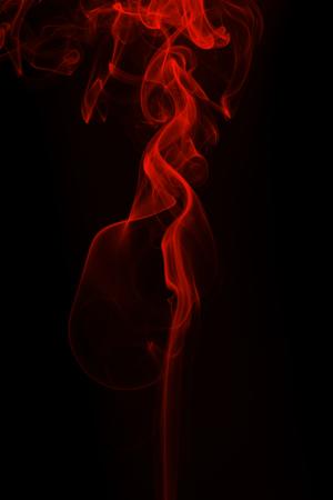 Movement of red smoke on black background Reklamní fotografie