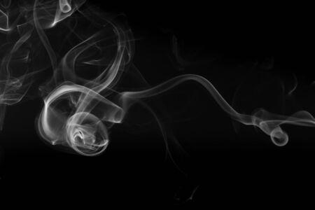Movement of white smoke on black background Reklamní fotografie