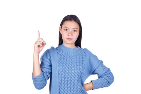 Portrait of young girl pointing finger up on white background