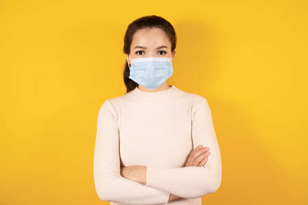 Portrait of Asian woman  in medical face mask to protect