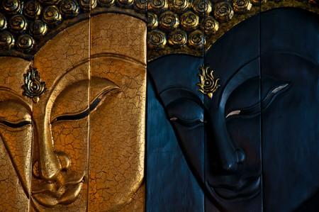 wood engrave image of buddha photo