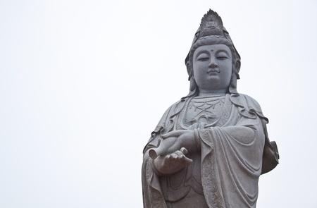 mercy: Kuan Yin Image of buddha in thailand ancient art Stock Photo