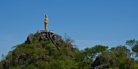 buddha standing on mountain in thailand
