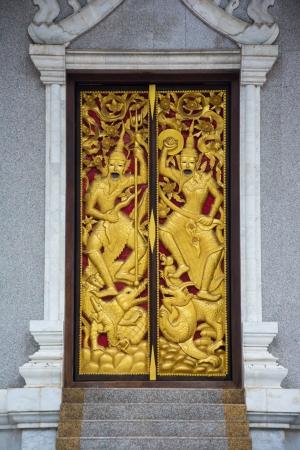 ancient Thai style temple door photo