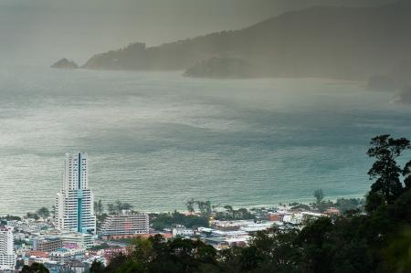 rain coming from phuket viewpoint top hill see to patong beach, phuket Thailand