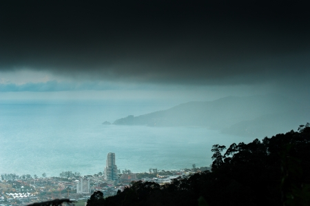 rain coming from phuket viewpoint top hill see to patong beach, phuket Thailand