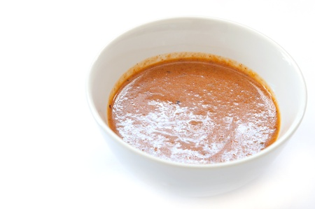 Peanut Sauce for Grilled Pork Satay with on white background Stock Photo