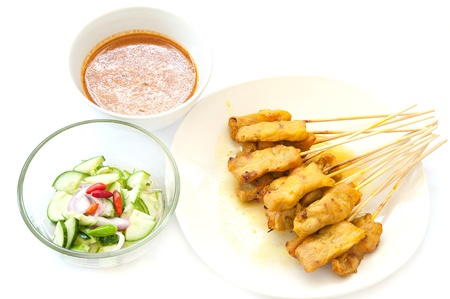 Grilled Pork Satay with Peanut Sauce and Vinegar on white background Stock Photo