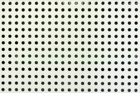 Hole grid grey pattern close-up photo
