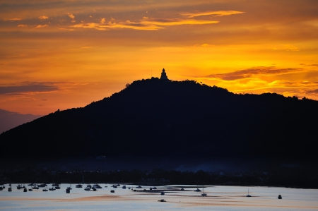 big Buddha on the top of mountain in twilight, looking from phuket view point photo