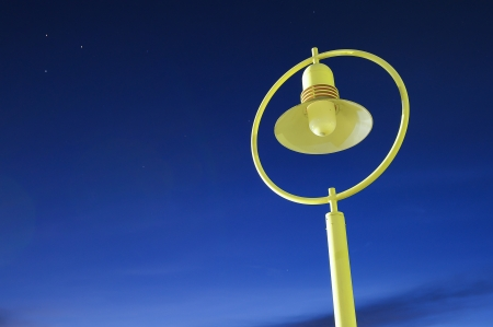 ancient Street lamp against twilight sky background photo